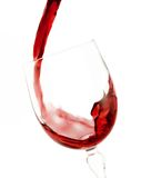 Red wine. Being poured into a wine glass Royalty Free Stock Images