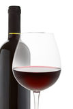 Red wine. Wineglass and bottle on a white background Royalty Free Stock Photo