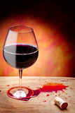 Red Wine. Spilled wine on a olive wooden table Stock Photography