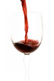Red wine. Being poured into a wine glass Stock Photo