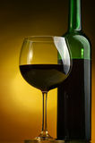 Red wine. Bottles and glasses of excellent wine on a dark background Royalty Free Stock Images