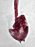 Red Wine. Pouring red wine into a wine glass stock photo