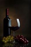 Red wine. Bottles and glasses of excellent wine on a dark background Royalty Free Stock Photos