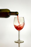 Red Wine. Pouring red wine into the glass Stock Photography
