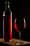 Red Wine. Red light in dim light Royalty Free Stock Photos