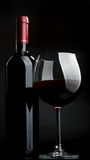 Red wine. Bottle and glass of red wine on a dark background Royalty Free Stock Photography