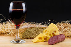 Red wine. And cheese, bread and salami composition Stock Photos