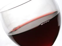 Red wine. Closeup of red wine and glass focus on the rim Stock Photos