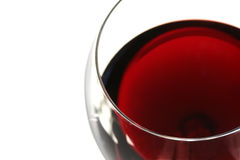 Red Wine. Closeup of a glass of red wine with white background. Shallow DOF stock images