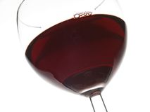Red wine. Close-up of red wine and glass, focus on blister in wine Stock Images