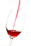 Red wine. In glass on a white background Stock Photos