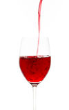 Red wine. In glass on a white background Stock Image