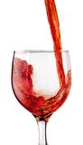 Red wine. Pouring into wine glass Royalty Free Stock Image