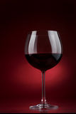 Red wine. Glass of red wine on a dark background Stock Image