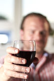 Red wine. Man holding a glass of red wine Stock Photography