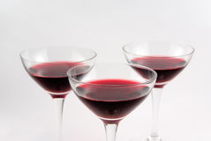 Red wine. Three glasses of red wine still life Royalty Free Stock Photos