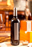 Red wine. The still life with red wine, bottle, glass and old barrel Royalty Free Stock Photography