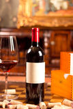 Red wine. The still life with red wine, bottle, glass and old barrel Royalty Free Stock Photo