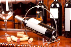 Red wine. The still life with red wine, bottle, glass and old barrel Royalty Free Stock Photos