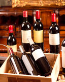 Red wine. The still life with red wine, bottle, glass and old barrel Stock Photography