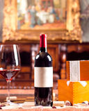 Red wine. The still life with red wine, bottle, glass and old barrel Stock Image