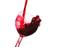 Red wine. Splash into glass isolated on white background Royalty Free Stock Photos