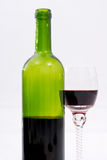 Red wine. Bottle and glass of red wine on white background Stock Images