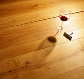 Red wine. Glass of red wine on wooden floor stock images