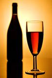 Red wine. Glass of red wine and a bottle royalty free stock images