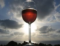 Red wine. Glass of red wine on the beach Stock Photos