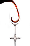 Red wine. Being poured into a wine glass stock image