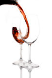 Red wine. Being poured into a wine glass Royalty Free Stock Photography