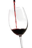 Red wine. Being poured into wineglass Stock Photos