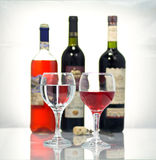 Red wine. Bottles of wine on a white background royalty free stock photos
