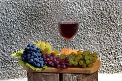 Red wine. From ripe  and fresh grapes Royalty Free Stock Photo