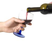 Red wine. Pouring red wine into a glass.Isolated on white background stock photography