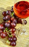 Red wine. Grapes and sunlight Stock Images