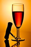 Red wine. Glass and corkscrew royalty free stock photo