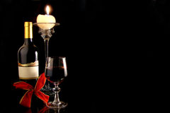 Red Wine. Composition with wineglass, wine bottle , candle and red loop Stock Image