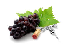 Red wine. Corkscrew, cork and grapes isolated over white Stock Image