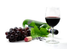 Red wine. Corkscrew, grapes bottle and glass isolated over white Stock Photo