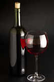 Red wine. Glass of red wine and bottle on black background Stock Photo