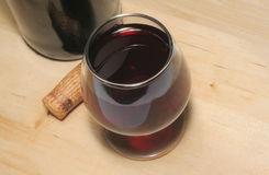 Red wine. In a glass stock photo