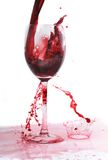 Red wine splashing in glass Royalty Free Stock Photo