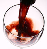 Red wine. Being poured into a wine glass Royalty Free Stock Photo