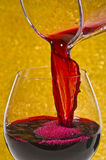 Red wine. Pouring from the jar into the wineglass Royalty Free Stock Image