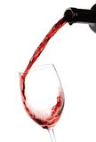 Red wine. Being poured into a wine glass Stock Images