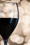 Red wine against blurred lights Stock Photo