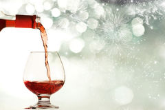 Red wine against fireworks Stock Images