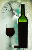 Red wine against holiday lights and clock Royalty Free Stock Images